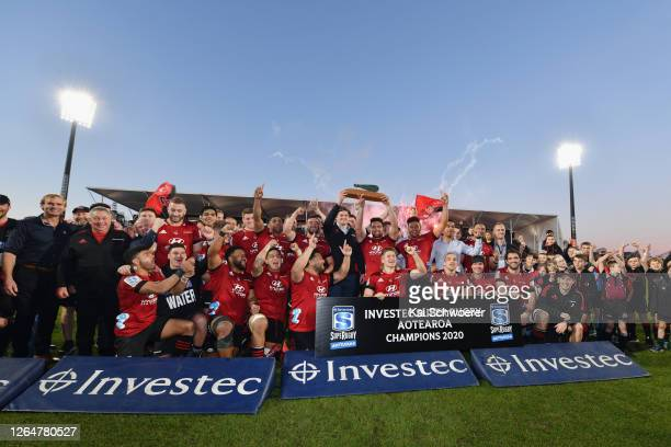 Captain Codie Taylor of the Crusaders and his team mates celebrate with the Super Rugby Aotearoa Trophy after their win in the round 9 Super Rugby...
