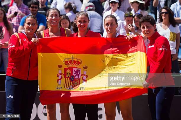 Captain Conchita Martinez, Garbine Muguruza, Sara Sorribes, Anabel Medina and Carla Suarez Navarro of Spain celebrate defeating Italy during day two...
