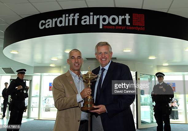 USA captain Corey Pavin and European captain Colin Montgomerie pose with the Ryder Cup trophy as the USA team arrive at Cardiff Airport on September...