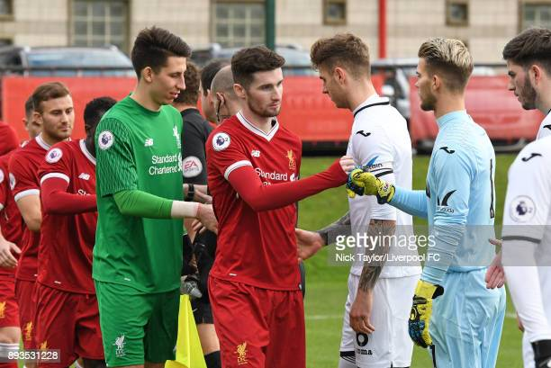 Captain Corey Whelan of Liverpool and goalkeeper Gregor Zabret of Swansea City during the hand shake before the Liverpool U23 v Swansea City U23 PL2...