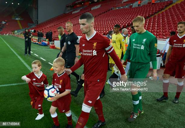 Captain Corey Whelan of Liverpool leads his team onto the pitch before the Liverpool v Tottenham Hotspur Premier League 2 game at Anfield on...