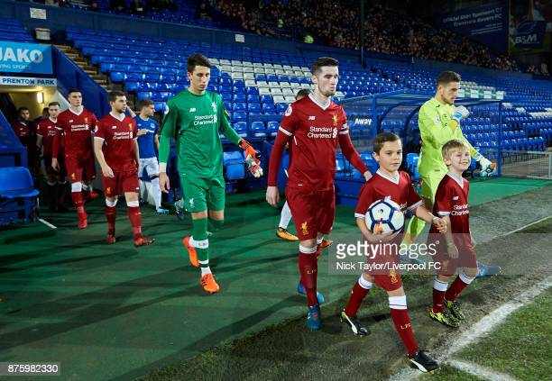 Captain Corey Whelan of Liverpool leads his team to the pitch for the start of the Liverpool v Everton Premier League 2 game at Prenton Park on...