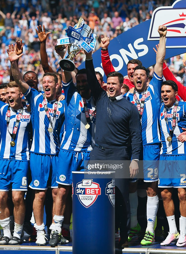Captain Craig Morgan of Wigan Athletic and Gary Caldwell manager of Wigan Athletic lift the trophy as they are crowned champions after the Sky Bet League One match between Wigan Athletic and Barnsley at DW Stadium on May 8, 2016 in Wigan, England.
