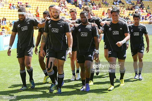 Captain D J Forbes of New Zealand leads the All Blacks Sevens squad off the field after warming up during the 2013 Wellington Sevens at Westpac...