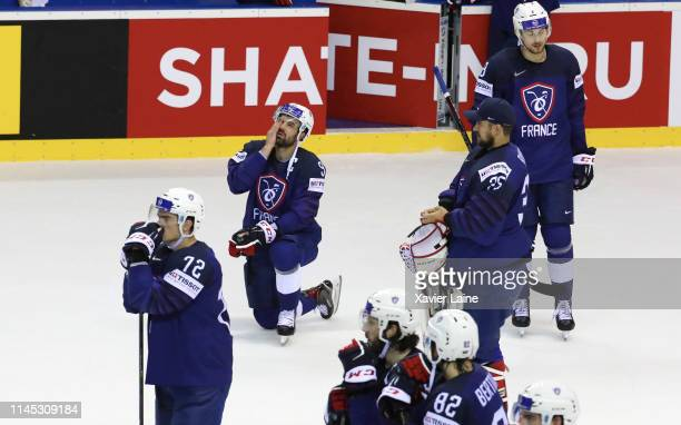 Captain Damien Fleury of France reacts with teammates after being defeated in the 2019 IIHF Ice Hockey World Championship Slovakia group A game...