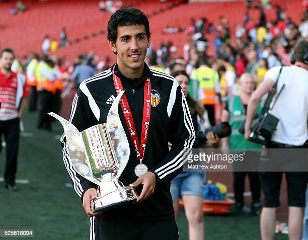 Captain Dani Parejo of Valencia holds the trophy after winning the Emirates Cup 2014