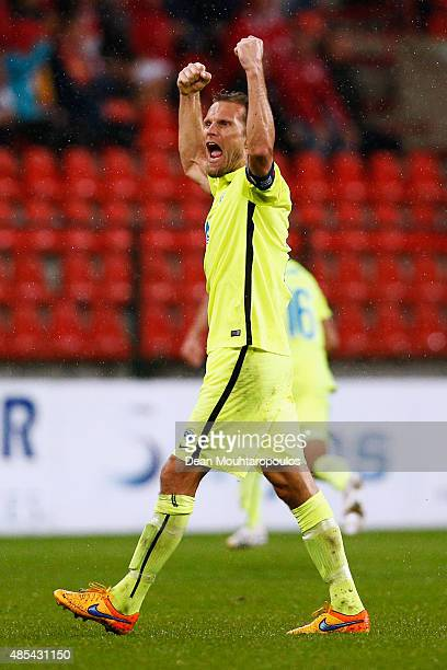 Captain Daniel Berg Hestad of Molde FK celebrates with his team after victory in the UEFA Europa League play off round second leg match between...