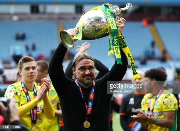 Captain Daniel Farke, Manager of Norwich City lifts the championship trophy in celebration after the Sky Bet Championship match between Aston Villa...