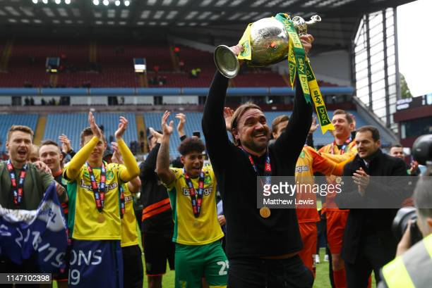 Captain Daniel Farke Manager of Norwich City lifts the championship trophy in celebration after the Sky Bet Championship match between Aston Villa...