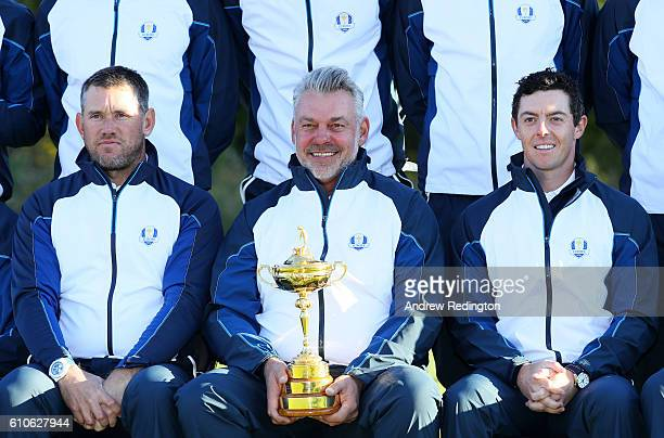 Captain Darren Clarke Lee Westwod and Rory McIlroy of Europe pose during team photocalls prior to the 2016 Ryder Cup at Hazeltine National Golf Club...