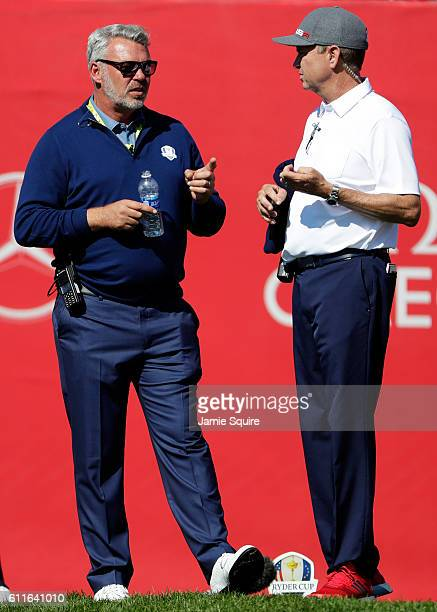 Captain Darren Clarke of Europe and captain Davis Love III of the United States wait on the first tee during afternoon fourball matches of the 2016...