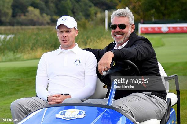 Captain Darren Clarke of Europe drives Danny Willett in a cart during practice prior to the 2016 Ryder Cup at Hazeltine National Golf Club on...