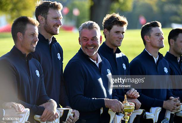 Captain Darren Clarke of Europe looks on with his team during team photocalls prior to the 2016 Ryder Cup at Hazeltine National Golf Club on...