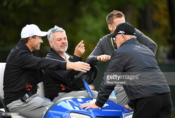 Captain Darren Clarke speaks to vicecaptains Padraig Harrington Ian Poulter and coach Pete Cowen of Europe during practice prior to the 2016 Ryder...