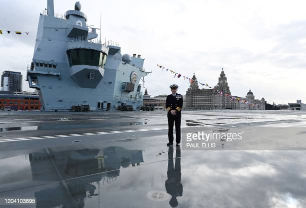 Captain Darren Houston stands on the flight deck of Britain's Royal Navy's HMS Prince of Wales during a media opportunity whilst it's moored near to...