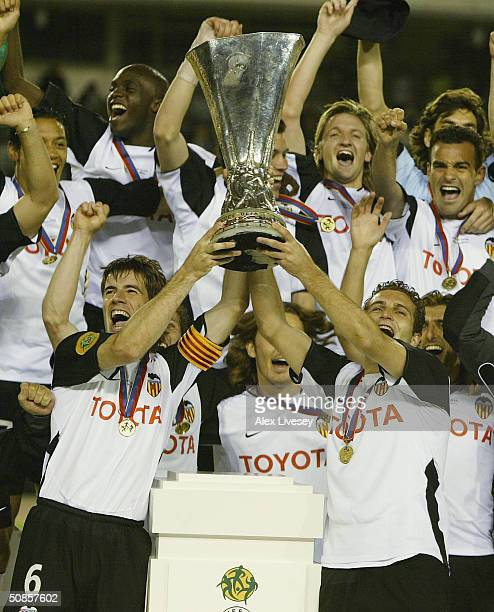 Captain David Albelda of Valencia celebrates with the UEFA cup during the UEFA Cup Final match between Valencia and Olympique de Marseille at the...
