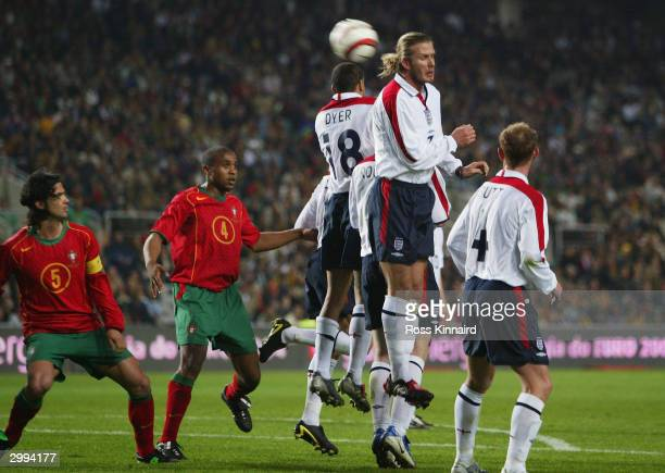 Captain David Beckham of England jumps high to try and stop the ball as it goes in for Portugal's first goal during the International Friendly match...