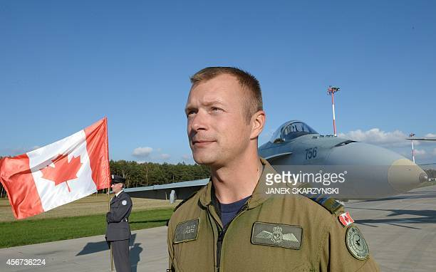 Captain David Pletz of Canada poses in front of his F18 fighter before the visit of new NATO Secretary General at the NATO troops stationed at the...