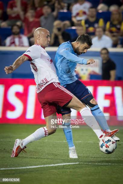 Captain David Villa of New York City FC takes the shot on goal past Aurélien Collin of the New York Red Bulls during the 2017 Hunt Lamar US Open...
