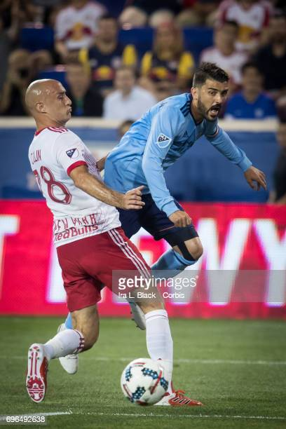 Captain David Villa of New York City FC tries to get a shot past Aurélien Collin during the 2017 Hunt Lamar US Open soccer match between New York Red...