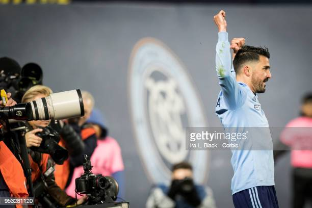 Captain David Villa of New York City points to the back of his jersey to celebrate his goal during the Major League Soccer match between New York...