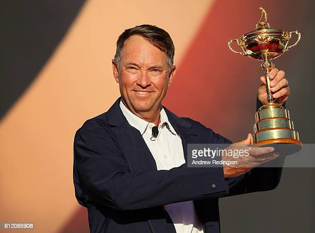 captain Davis Love III of the United States holds the Ryder Cup after defeating Europe during singles matches of the 2016 Ryder Cup at Hazeltine...