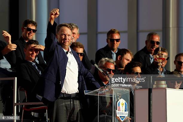 Captain Davis Love III of the United States holds the Ryder Cup at the closing ceremonies after defeating Europe during singles matches of the 2016...