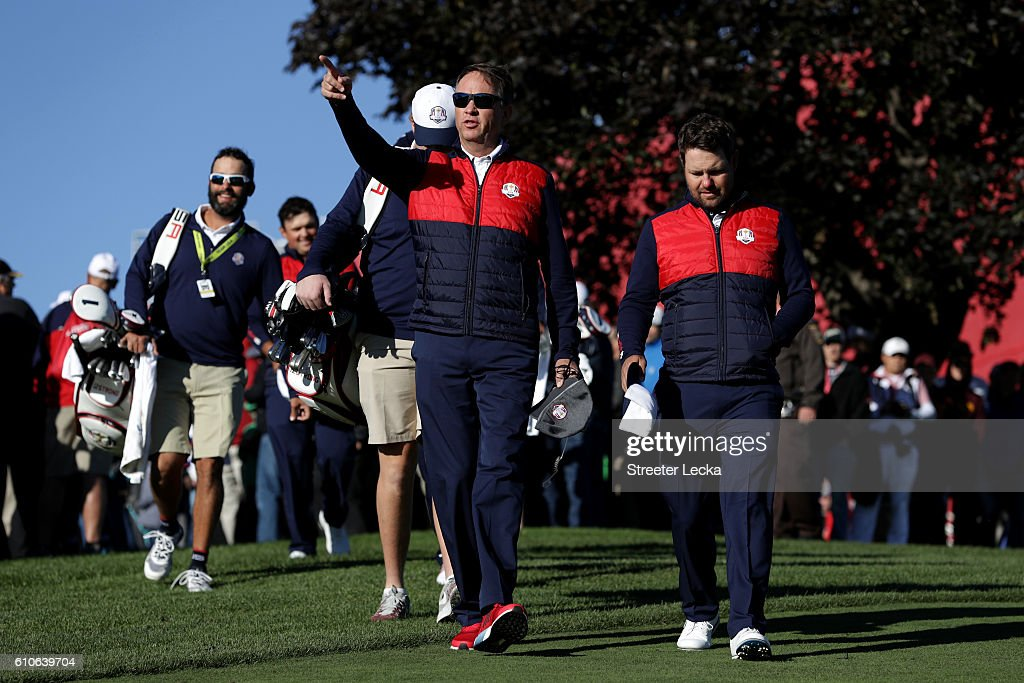 Captain Davis Love III walks with his team during team photocalls prior to the 2016 Ryder Cup at Hazeltine National Golf Club on September 27, 2016 in Chaska, Minnesota.