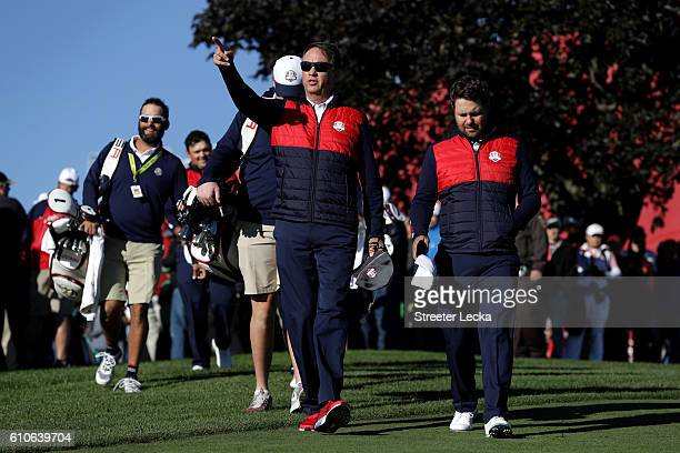 Captain Davis Love III walks with his team during team photocalls prior to the 2016 Ryder Cup at Hazeltine National Golf Club on September 27, 2016...