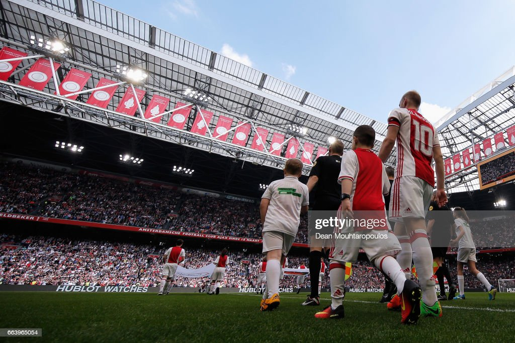 Captain, Davy Klaassen of Ajax walks out to play the Dutch Eredivisie match between Ajax Amsterdam and Feyenoord at Amsterdam ArenA on April 2, 2017 in Amsterdam, Netherlands.