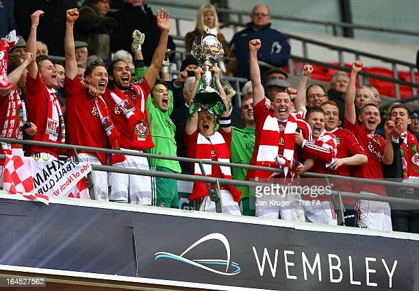 Captain Dean Keates of Wrexham lifts the trophy as his team mates celebrate after winning the FA Trophy Final between Wrexham and Grimsby Town at...