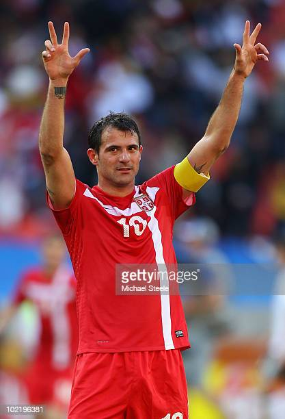 Captain Dejan Stankovic of Serbia celebrates victory in the 2010 FIFA World Cup South Africa Group D match between Germany and Serbia at Nelson...