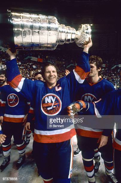 Captain Denis Potvin of the New York Islanders hoists the Stanley Cup after winning the 1982 Stanley Cup Finals against the Vancouver Canucks at the...