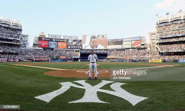Captain Derek Jeter of the New York Yankees speaks during the ceremony for owner George Steinbrenner and Yankee Stadium public address announcer Bob...