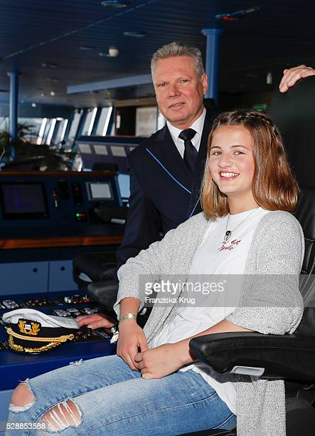 Captain Detlef Harms and child actress and godmother Emma Tiger Schweiger during the AIDAprima Cruise Ship Baptism on May 7 2016 in Hamburg Germany
