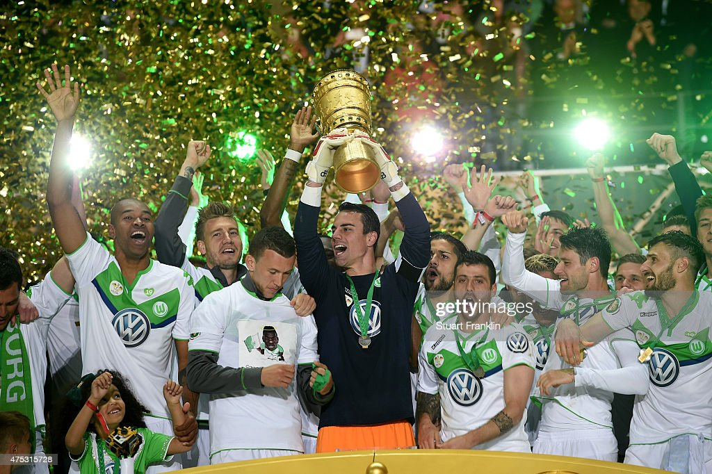 Captain Diego Benaglio of VfL Wolfsburg lifts the trophy with team mates to celebrate victory after the DFB Cup Final match between Borussia Dortmund and VfL Wolfsburg at Olympiastadion on May 30, 2015 in Berlin, Germany