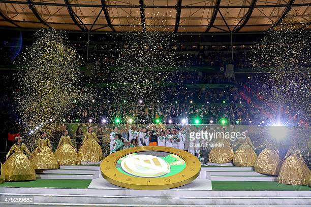 Captain Diego Benaglio of Wolfsburg lifts the trophy to celebrate with his team mates after winning the DFB Cup Final between Borussia Dortmund and...