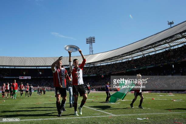 Captain Dirk Kuyt of Feyenoord Rotterdam celebrates with team mate Steven Berghuis infront of the home fans after winning the Dutch Eredivisie at De...