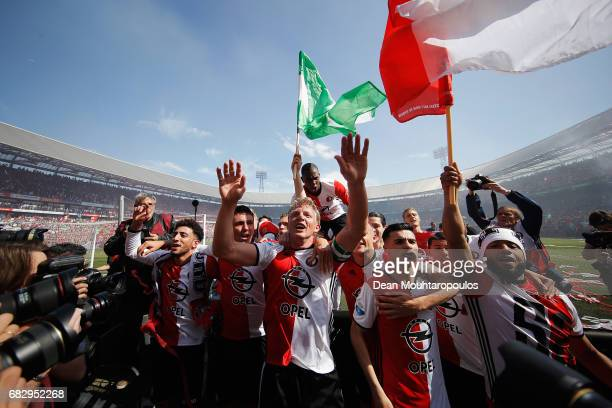 Captain Dirk Kuyt of Feyenoord Rotterdam celebrates with team mates after winning the Dutch Eredivisie at De Kuip or Stadion Feijenoord on May 14...