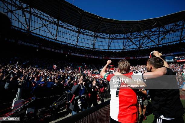 Captain, Dirk Kuyt of Feyenoord Rotterdam celebrates with team mates infront of the home fans after winning the Dutch Eredivisie at De Kuip or...