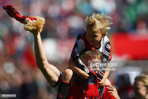 Captain Dirk Kuyt of Feyenoord with his son celebrates infront of the fans after winning the Dutch Eredivisie at De Kuip or Stadion Feijenoord on May...