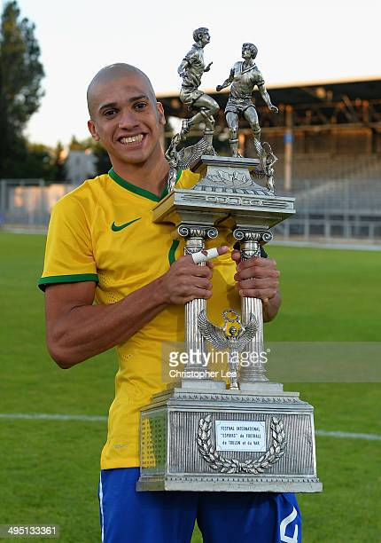 Captain Doria of Brazil celebrates their victory with the trophy during the Final of the Toulon Tournament between France and Brazil at the Parc des...