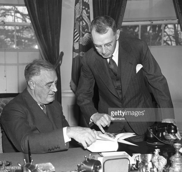Captain Dudley Knox Navy Historian as he presented to President Roosevelt the seventh and final volume of a collection of old Naval documents started...