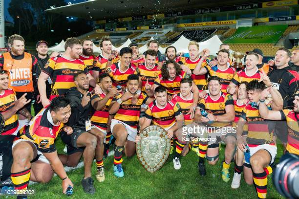 Captain Dwayne Sweeney of Waikato and his team mates pose with the Ranfurly Shield after their win in the round four Mitre 10 Cup Ranfurly Shield...