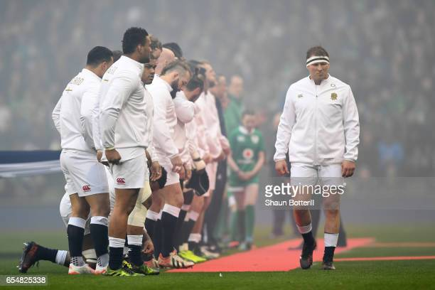 Captain Dylan Hartley of England and his team line up for the national anthems prior to kickoff during the RBS Six Nations match between Ireland and...