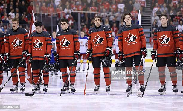 Captain Dylan Strome of Team Canada and his teammates stand for the anthem prior to action against Team Russia during a game at the the 2017 IIHF...