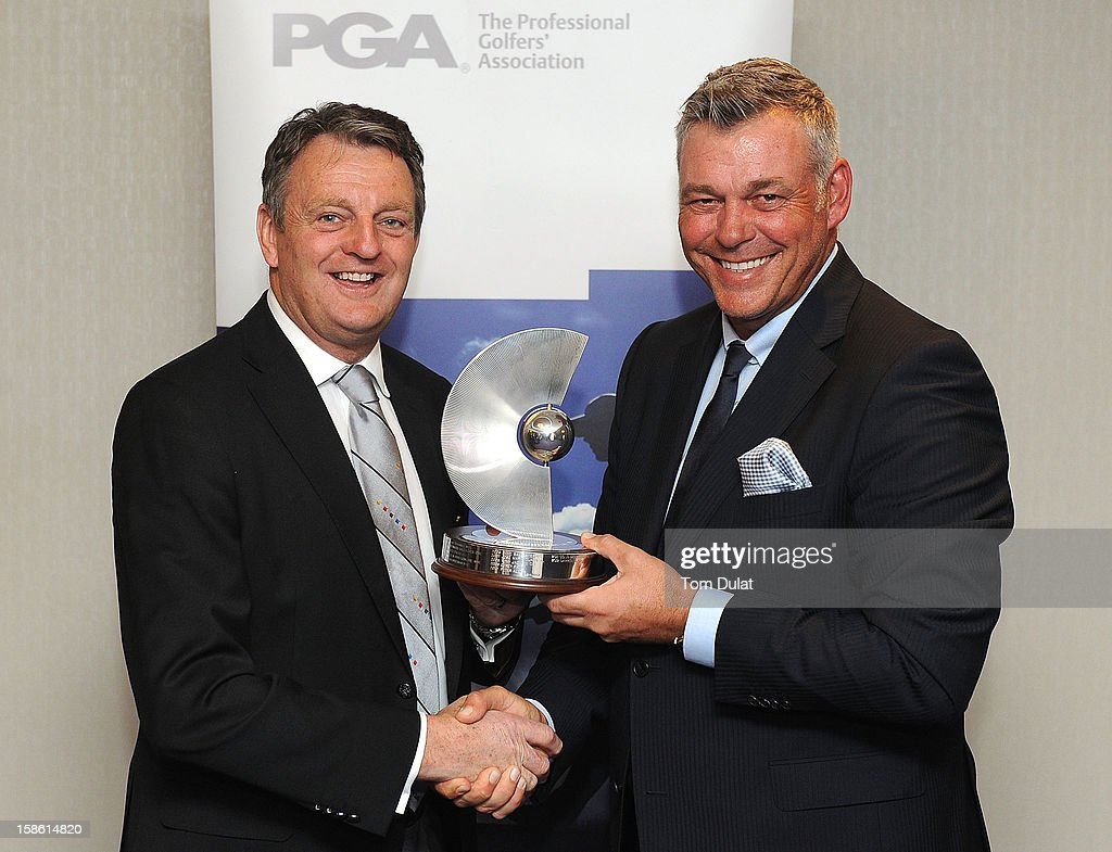 PGA Captain Eddie Bullock (L) gives PGA Recognition Award to Darren Clarke (R) during the PGA Lunch on December 21, 2012 in London, England.