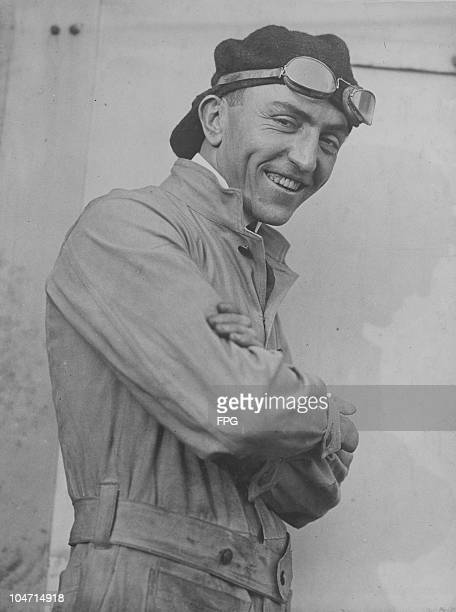 Captain Eddie Rickenbacker pictured smiling while wearing flying goggles raised above his eyes circa 1930