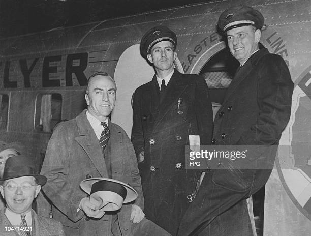 Captain Eddie Rickenbacker with his copilot E R Brown and Erlon H Parker after their aircraft had landed at Newark Airport New Jersey USA 13 November...