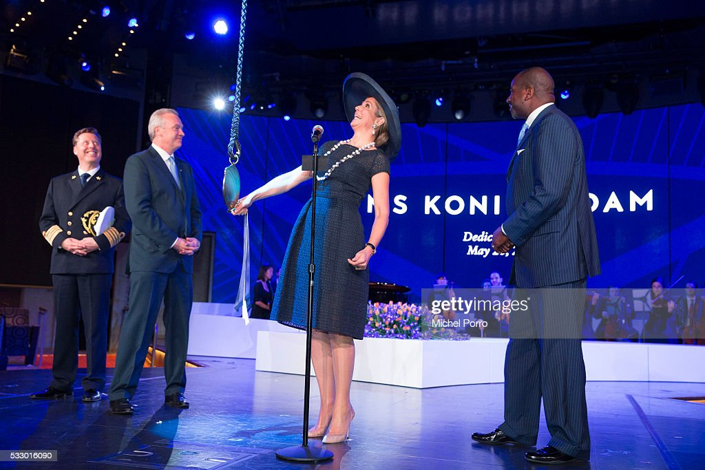 Captain Emiel de Vries, Stein Kruse, CEO Holland America Group and Orlando Ashford, President Holland America Line watch Queen Maxima of The Netherlands baptizing the cruise ship MS Koningsdam on May 20 2016 in Rotterdam Netherlands.